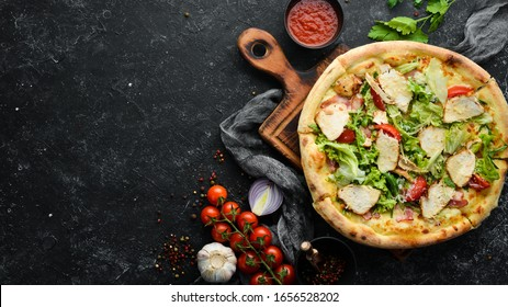 Pizza Caesar. Pizza with chicken, cheese and lettuce. Top view. Free space for your text.