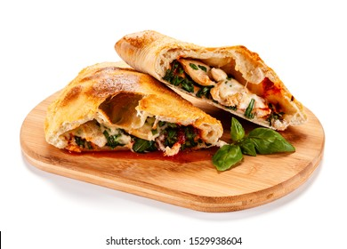 Pizza calzone on cutting board on white background