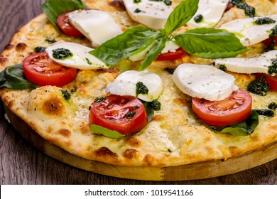 Pizza Caprese with basil and mozarella