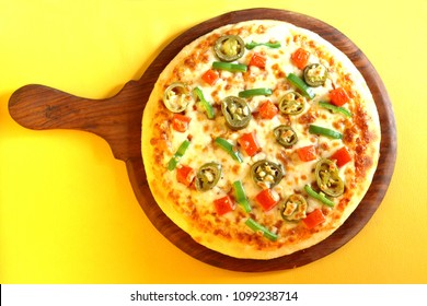 pizza with capsicum, olives and tomato is just mouthwatering thing in the world.