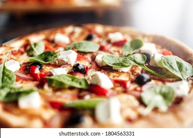Pizza with with cheese, olives and herbs. Cafe, pizzeria and restaurant menu.