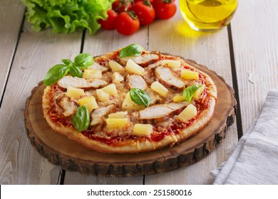 Pizza with cheese and pineapple chicken on board