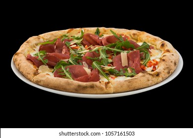 pizza with cheese, prosciutto and rucola isolated on black background