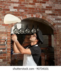 Pizza Chef makes the pizza dough spin in the air to make it thin and soft