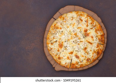 Pizza with chicken and cheese top view with copy space