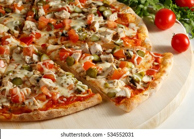 Pizza with chicken and pickles on a white background. Slice of pizza.