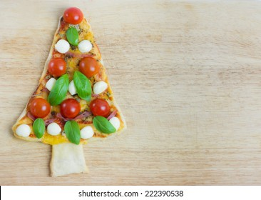 Pizza Christmas tree. Christmas concept with copy space