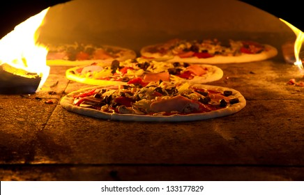Pizza cooking in a tradition oven