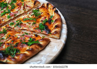 pizza, cut on the board