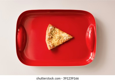 Pizza cut on red tray. Flat lay
