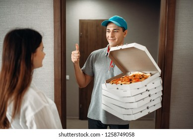 Pizza delivery boy shows thumbs up to customer