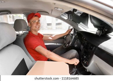 Pizza delivery man driving a car