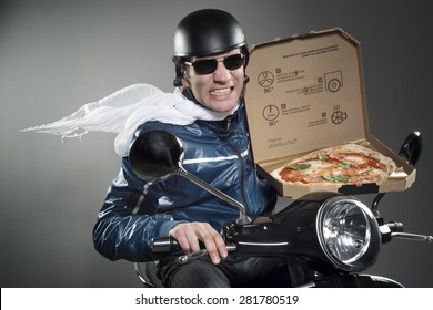 Pizza delivery. Man on motorbike holding pizza.