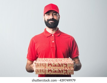 Pizza delivery man over grey background