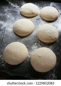 pizza dough rolls on baking tray