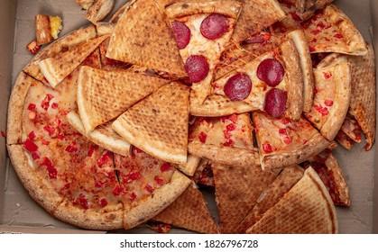pizza food dumped in trash