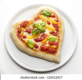 Pizza in the form of heart on the dish