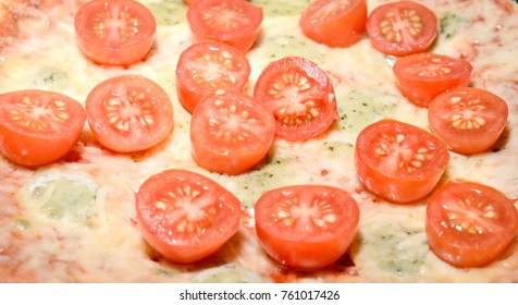pizza four cheeses with cherry tomatoes