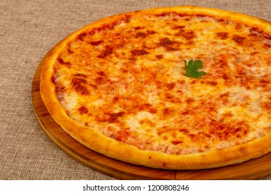 Pizza four cheeses over wooden background