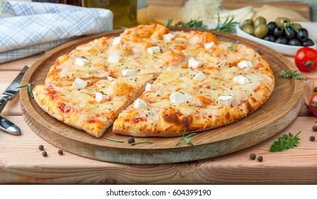 "Pizza ""Four cheeses"" with tomato sauce, artichoke hearts, olives, Parmacotto, fresh mozzarella, parmesan"