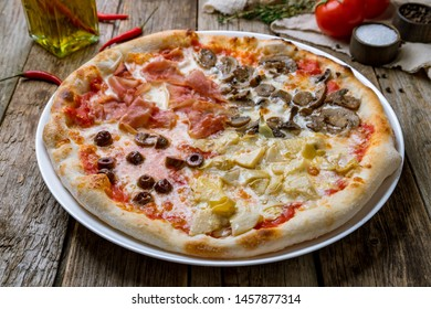 Pizza four seasons on wooden table