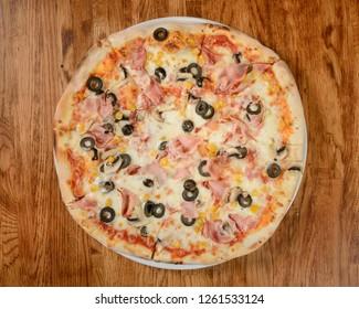 Pizza four seasons quattro stagioni top view