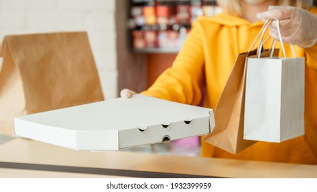 Pizza to go, takeaway Pizza coffee, Food delivery. Woman in gloves work with takeaway orders. Waiter giving takeout meal while city covid 19 lockdown, coronavirus shutdown.Long web banner.