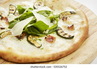Pizza Golosa served on wood pizza tray, ( Mozzarella, Blue Cheese, Italian Bacon, Grilled , Wild Rocket and Sliced Parmesan )