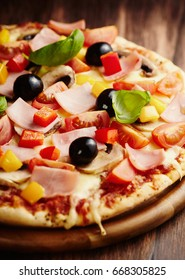 Pizza with Ham, Olives and Mushrooms