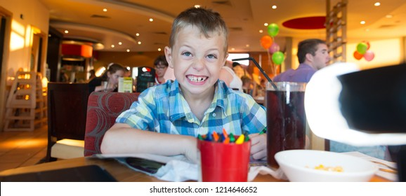 Pizza Hut, Clacton on Sea, Essex - 1st April 2017 - A cute little boy with ADHD, Aspergers Syndrome, Autism has fun playing and drawing with colouring crayons before his meal