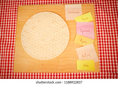 Pizza ingredients on sticky notes, a social hatred concept