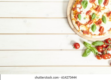 Pizza Margherita on wooden table