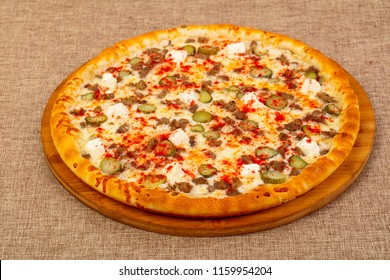 Pizza mix assortie with meat and cheese