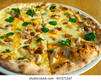 Pizza with mushrooms, cheese and herbs