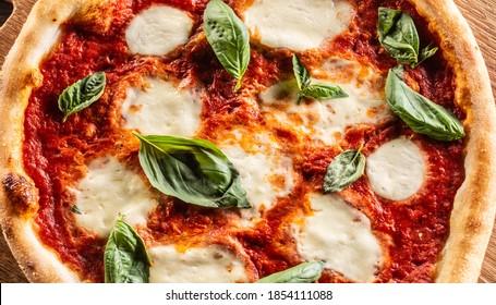 Pizza Napoletana - Napoli tomato sauce mozzarella and basil.