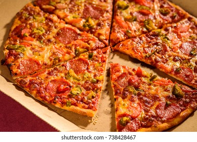 Pizza on a box and brown background