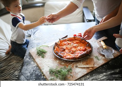 pizza on the family table, lifestyle in a real interior, toning