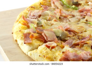 pizza on wood isolated in a white background