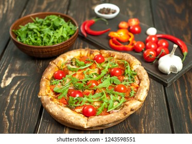 pizza on wood table with ingredients