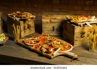 Pizza on a wooden tray