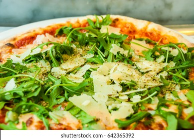 Pizza parma arugula ham parmesan tomato italian