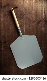 pizza peel paddle italian style with wood handle on wooden table
