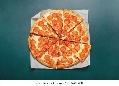 Pizza peperoni in green blackboard. Diet concept.