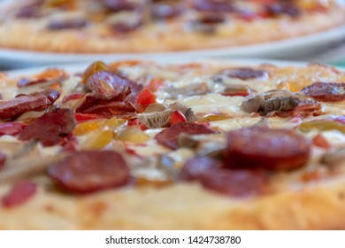 Pizza Peperoni with mushrooms and cheese on plate