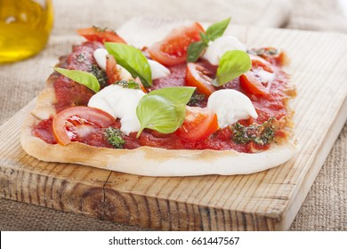 pizza pomodoro, vegetarian and homemade with mozzarella, tomatoes and basil isolated on white background