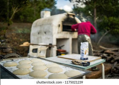 pizza preparations in a self-built wooden oven
