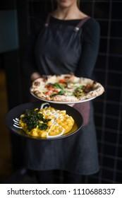 Pizza and Pumpkin Gnocchi at Italian Restaurant