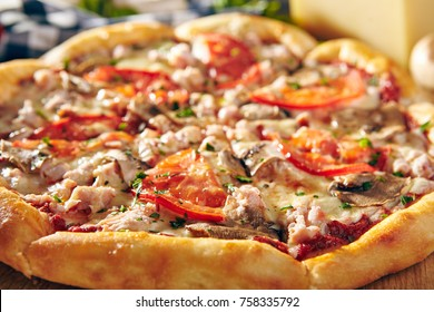 Pizza Restaurant Menu - Delicious Fresh Pizza with Mushrooms, Tomatoes and Meat. Pizza on Rustic Wooden Table with Ingredients.