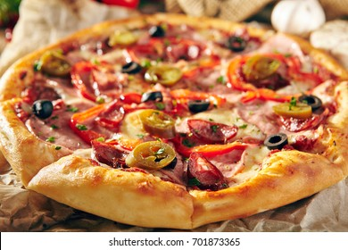 Pizza Restaurant Menu - Delicious Spicy Pizza with Sausages and Chili Pepper. Pizza on Rustic Wooden Table with Ingredients.