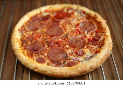 pizza with salami in the oven